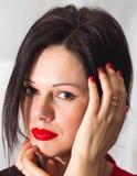 Красивая девушка в красном цвете Стоковые Фото