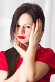 Красивая девушка в красном цвете Стоковое Фото