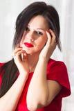 Красивая девушка в красном цвете Стоковая Фотография