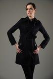 Красивая девушка в пальто стоковое фото rf