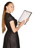 Красивая девушка держа доску зажима в его руках Стоковые Изображения