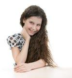 Красивая девушка за таблицей Стоковые Фотографии RF