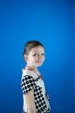 Красивая девушка на голубой предпосылке Стоковые Фото