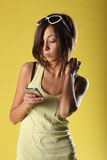 Красивая девушка на желтой предпосылке Стоковое фото RF