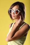 Красивая девушка на желтой предпосылке Стоковые Фотографии RF