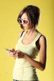 Красивая девушка на желтой предпосылке Стоковая Фотография