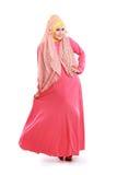 Красивая девушка нося розовый костюм мусульман стоковое фото