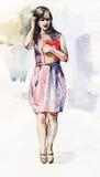 Красивая девушка оставаясь с иллюстрацией акварели папки Стоковые Изображения
