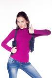 Красивая девушка показывает класс большого пальца руки Стоковое фото RF
