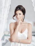 Красивая женщина в выскальзывании стоковые фотографии rf