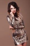 Красивая женщина в сияющем платье стоковая фотография rf
