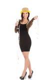 Красивая женщина в черном платье, золотой шляпе и шампанском. Стоковое Изображение