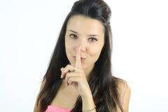 Красивая женщина делая shh с ее пальцем стоковые фото