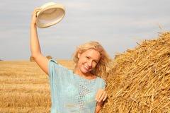 Красивая женщина около стога сена Стоковое фото RF