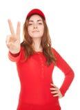 Красивая женщина показывая знак или мир победы изолированные на белизне Стоковое фото RF