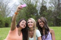 Красивая женщина 3 принимает фото Стоковое Изображение RF