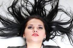 Красивая женщина с длинными волосами стоковые изображения