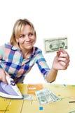 Красивая женщина с долларами и утюгом Стоковая Фотография