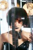 Красивая женщина с стилем причёсок filmstrips Стоковое фото RF