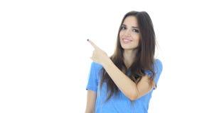 Красивая женщина указывая показывать в сторону, белая предпосылка стоковое изображение rf