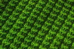 Красивая зеленая вязать текстура шерстей стоковая фотография