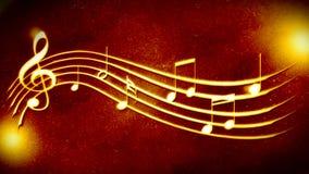 Красивая золотая нотация музыки предпосылки Стоковое фото RF