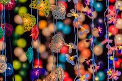 Красивая линия занавеса освещения СИД с bokeh на ноче Abst Стоковая Фотография