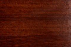 Красивая коричневая деревянная предпосылка на отлакированной текстурированной переклейке стоковое фото rf