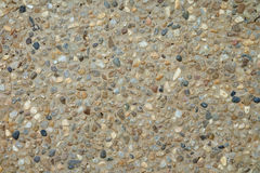Красивая, красочная каменная стена с малым камнем в цементе Стоковые Фото