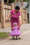 Красивая маленькая девочка в модельном платье Стоковые Изображения