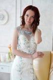 Красивая маленькая девочка в платье вечера представляя на внутреннем фото s Стоковое Изображение