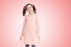 Красивая маленькая девочка в розовом платье Стоковые Изображения