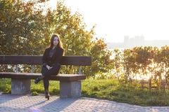 Красивая маленькая девочка на предпосылке природы Стоковая Фотография