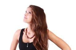 Красивая мечтая девушка смотрит вверх Стоковая Фотография