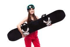 Красивая молодая женщина брюнет в черном коротком снеге владением верхней части танка стоковое изображение