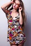 Красивая молодая женская сторона с составом яркой моды пестротканым. Стоковые Фотографии RF