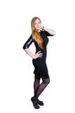 Красивая молодая женщина redhead на белой предпосылке Стоковые Изображения RF