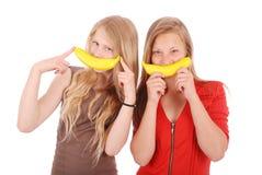 Красивая молодая кавказская девушка 2 с улыбкой банана Стоковые Изображения RF