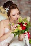 Красивая невеста в белой студии Стоковые Изображения