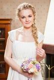 Красивая невеста около камина Стоковые Фото