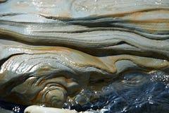 Красивая поверхность камня в воде Стоковое Изображение