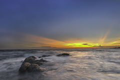 Красивая предпосылка пляжа захода солнца природы Стоковое Изображение