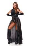 Красивая сексуальная молодая женщина в черной юбке, черные ботинки, полнометражное фасонируйте девушку Изолировано на белизне Стоковое Изображение RF