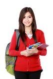 Красивая студентка с усмехаться книг Стоковое фото RF