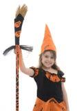 Красивая счастливая девушка ведьмы с веником Стоковое фото RF
