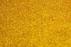 Красивая текстура желтого цвета сверкнает предпосылка яркого блеска глянцеватая текстура стоковые фотографии rf