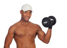 Красивая тренировка парня с гантелями стоковое фото rf