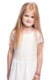 Красивая усмехаясь годовалая маленькая девочка 4 стоковое изображение