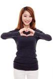 Красивейшая азиатская вскользь форма сердца выставки женщины. Стоковые Изображения
