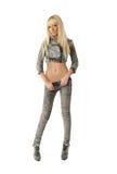 Красивейшая белокурая женщина в джинсыах Стоковые Изображения RF